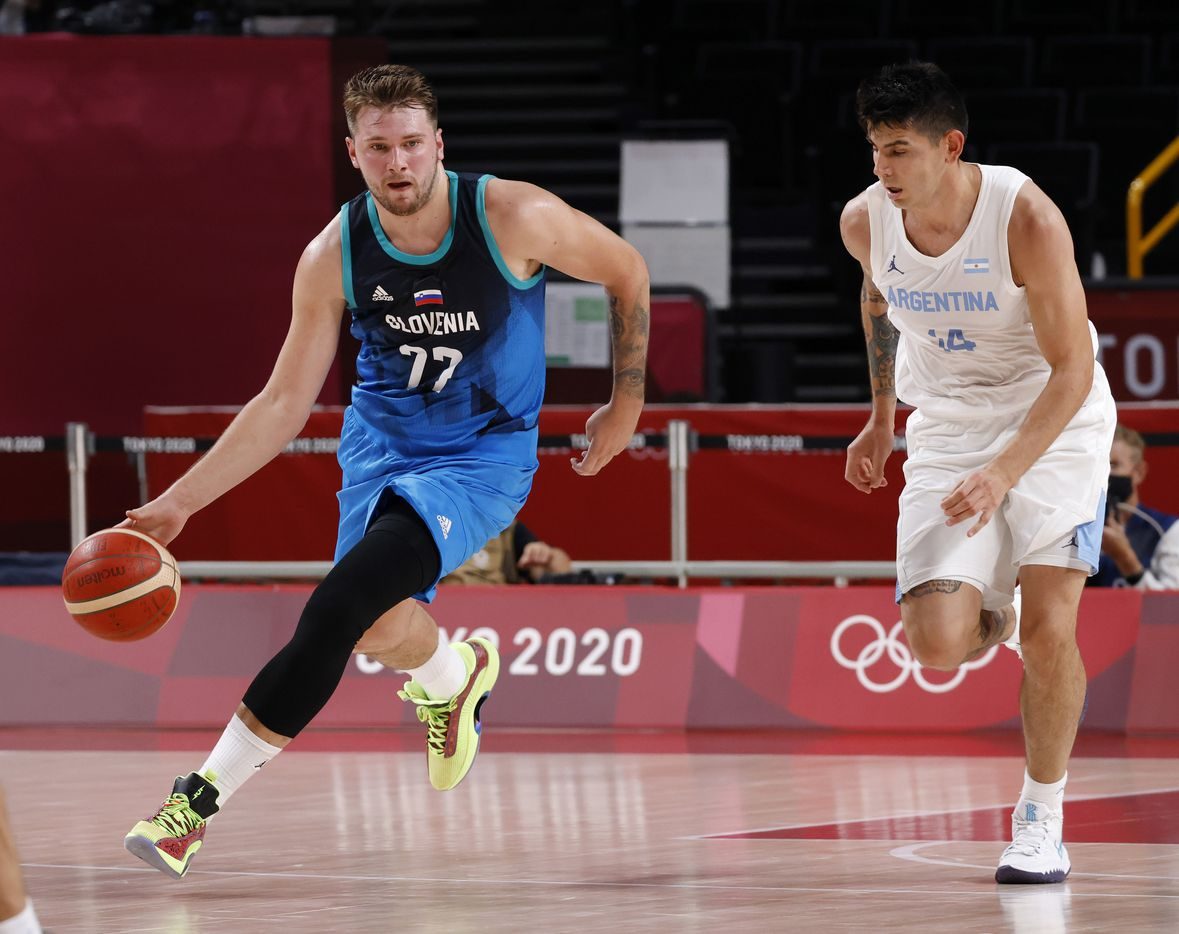 Slovenia's Luka Doncic (77) drives up the court as Argentina's Gabriel Deck (14) defends in the second half of play during the postponed 2020 Tokyo Olympics at Saitama Super Arena on Monday, July 26, 2021, in Saitama, Japan. Slovenia defeated Argentina 118-100. (Vernon Bryant/The Dallas Morning News)