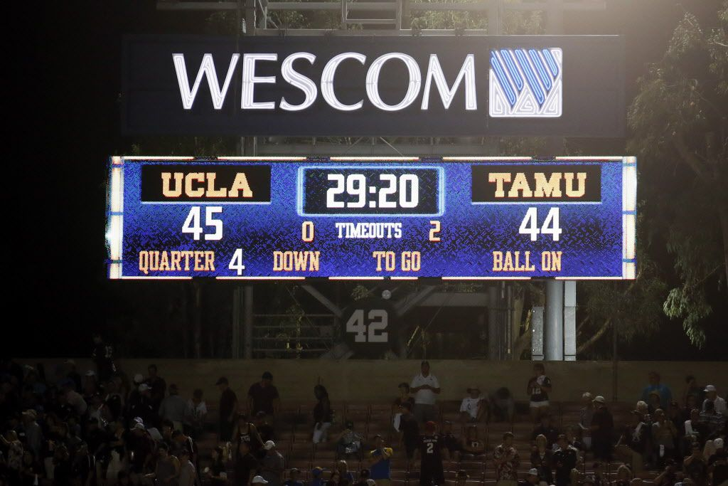 The scoreboard is seen after UCLA defeated Texas A&M in an NCAA college football game, Sunday, Sept. 3, 2017, in Pasadena, Calif. UCLA won 45-44. (AP Photo/Danny Moloshok)