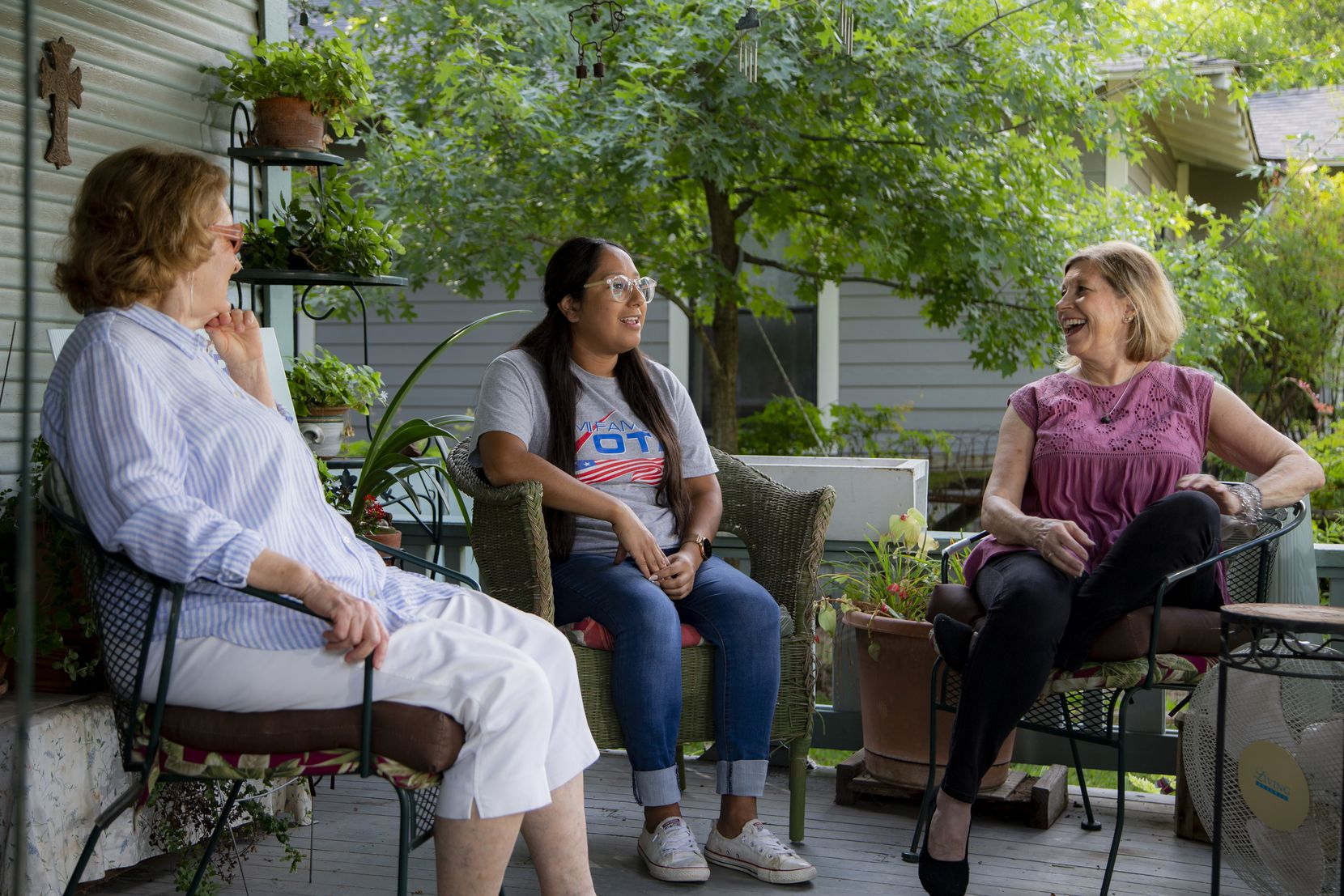 Karen Roberts (from left), Sarah Mendoza and Jeanne Chvosta, on Roberts' front porch, are among the longtime Mount Auburn residents working to revive the area's neighborhood association.
