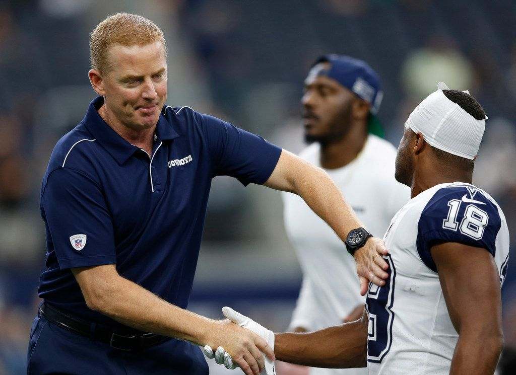 Dallas Cowboys head coach Jason Garrett greets Dallas Cowboys wide receiver Randall Cobb (18) during warmups before a game against the Miami Dolphins at AT&T Stadium in Arlington, Texas on Sunday, September 22, 2019