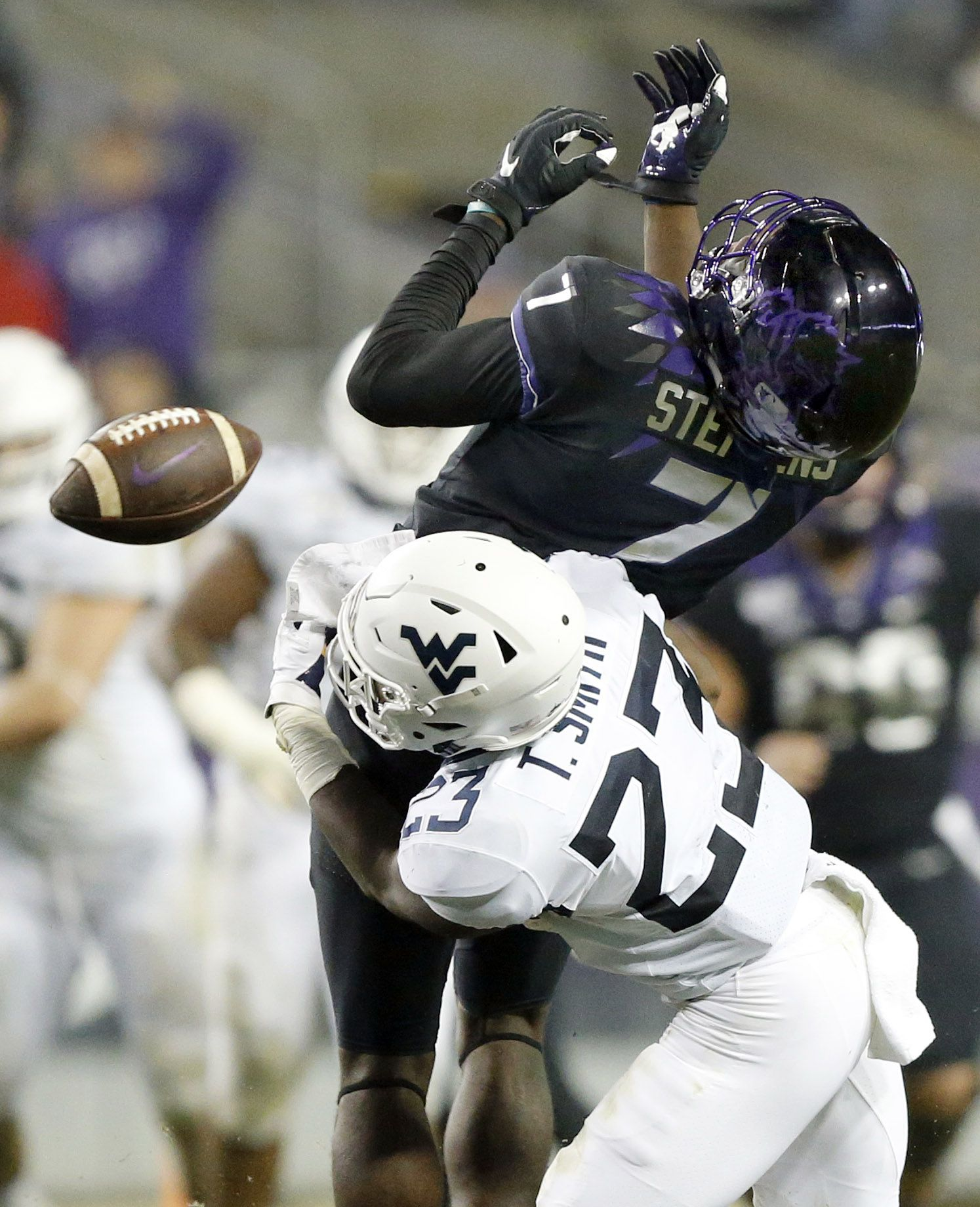 West Virginia Mountaineers safety Tykee Smith (23) puts a big hit on TCU Horned Frogs wide receiver John Stephens Jr. (7) forcing the fourth quarter incompletion at Amon G. Carter Stadium in Fort Worth, Friday, November 29, 2019. The Horned Frogs lost, 20-17.