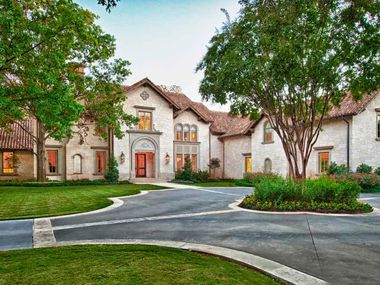 This 10,382 square foot home at 10203 Hollow Way in Old Preston Hollow is listed at $8.9 million.