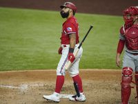 Texas Rangers designated hitter Rougned Odor reacts after striking out with the bases loaded to end the fourth inning as Los Angeles Angels catcher Max Stassi heads for the dugout at Globe Life Field on Friday, Aug. 7, 2020.