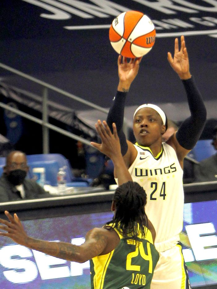 Dallas Wings guard Arike Ogunbowale (24) puts up a jump shot over the defense of Seattle guard Jewell Loyd (24) during the first half. The Wings hosted the Storm for their WNBA 2021season home opener at UTA's College Park Center in Arlington on May 22, 2021. (Steve Hamm/ Special Contributor)