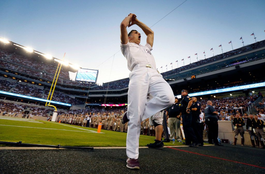 Gavin Suel, a junior yell leader, leads a cheer before halftime of the Texas A&M Aggies Nicholls State Colonels game at Kyle Field in College Station, Texas, Saturday, September 9, 2017. (Tom Fox/The Dallas Morning News)