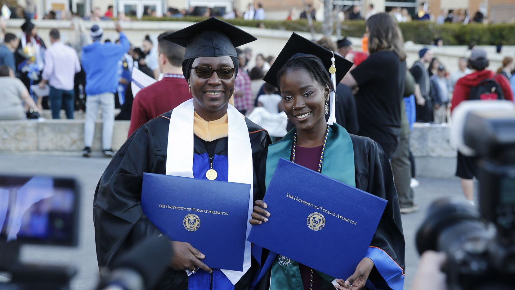 Ndeye Ndaw and daughter Awa Sy pose for a photo together outside College Park Center at the University of Texas at Arlington shortly after graduation ceremonies in 2019.  Ndeye earned a master's degree and her daughter Awa earned her bachelor's degree on the same day.