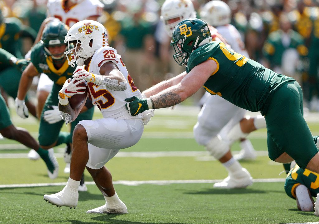 Baylor Bears defensive tackle James Lynch (93) tackles Iowa State Cyclones running back Sheldon Croney Jr. (25) on a run play during the first half of play at McLane Stadium in Waco, Texas on Saturday, September 28, 2019. (Vernon Bryant/The Dallas Morning News)