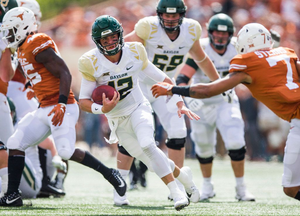 FILE - Baylor Bears quarterback Charlie Brewer (12) runs the ball during the first quarter of a college football game between Baylor and the University of Texas on Saturday, October 13, 2018 at Darrell K Royal Memorial Stadium in Austin, Texas.  (Ashley Landis/The Dallas Morning News)