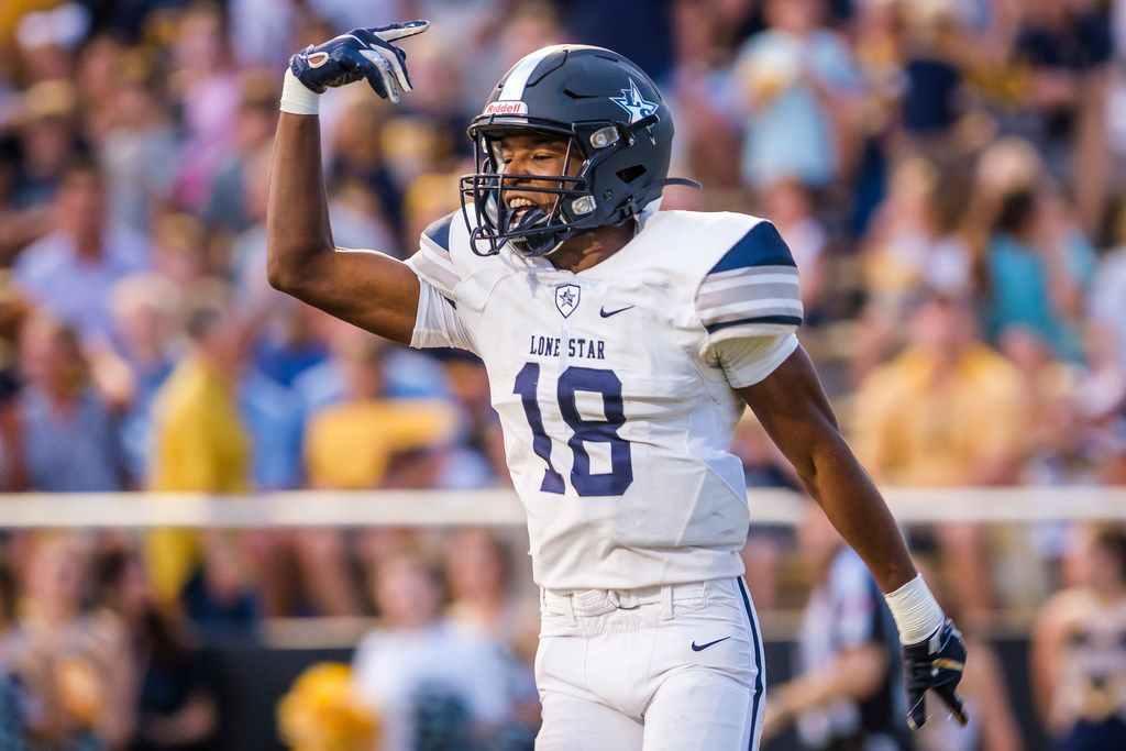 Frisco Lone Star wide receiver Marvin Mims celebrates after scoring on a touchdown reception on the first play from scrimmage during a high school football game against Highland Park at Highlander Stadium on Friday, Sept. 13, 2019, in Dallas. (Smiley N. Pool/The Dallas Morning News)