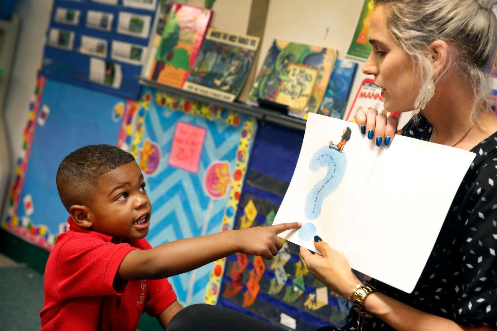 CP Preparatory School student Ethan Johnson, 4, points to the final page of 'Chimps Don't Wear Glasses' and questions instructor Erin Jones. Mesquite ISD is dipping deeper into early intervention by partnering with day cares to provide free pre-K for qualifying 3-year-olds. CP Preparatory School is one of seven pilot sites for the fall. (Tom Fox/The Dallas Morning News)