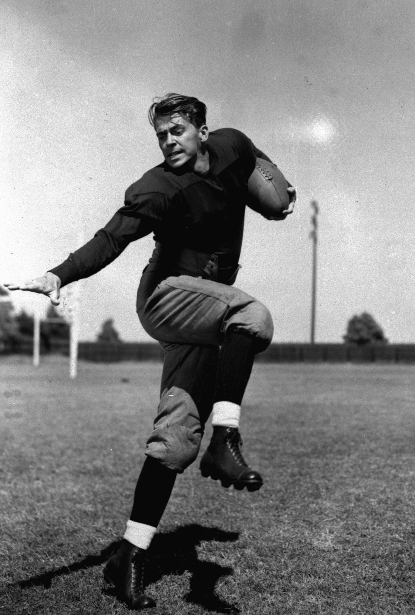 "ORG XMIT: *S0409119991* **FILE** A posed action photo of Ronald Reagan playing the doomed Notre Dame halfback George Gipp in the 1940 film "" Knute Rockne - All American. "" Reagan died Saturday, June 5, 2004 after a long twilight struggle with Alzheimer's disease. He was 93.  (AP Photo, file)