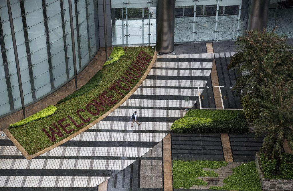 A garden with 'Welcome to Huawei' spelled out in flowers is seen outside an office building  at the company's Bantian campus in Shenzhen, China.