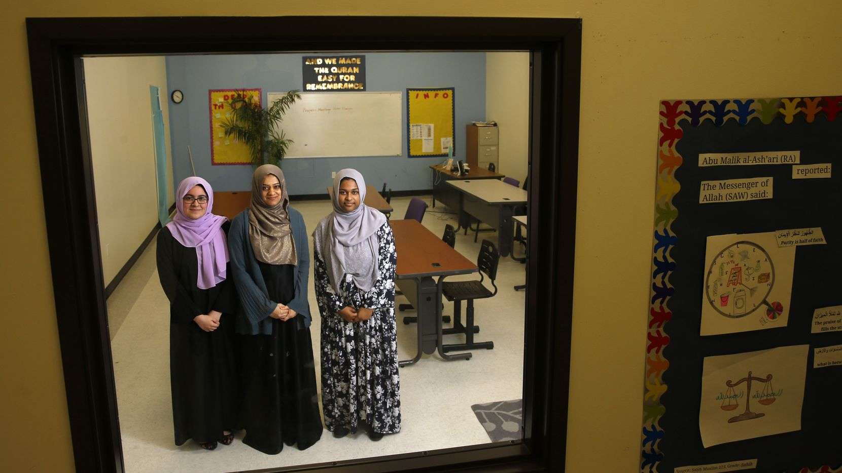 Viewed through a window, student Iman Ikram (from left), principal Fawzia Belal and student Sadia Sarwer are three of the figures who make Qalam Collegiate Academy a unique place. Ikram was this past year's valedictorian, and Sarwer will be a senior next school year.