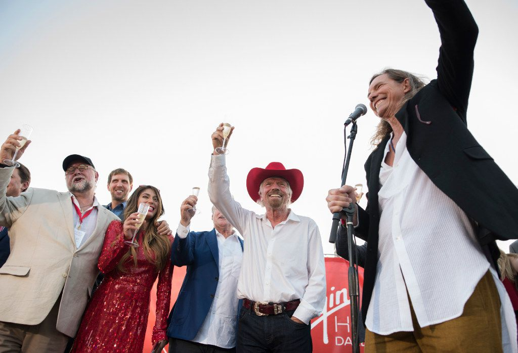 Bill Hutchinson (Founder and President of Dunhill Partners), right, toasts Richard Branson's, second from right, new Virgin Hotel after the ground breaking in the Design District on Monday, Oct. 17, 2016.   (Rex C. Curry/Special Contributor)