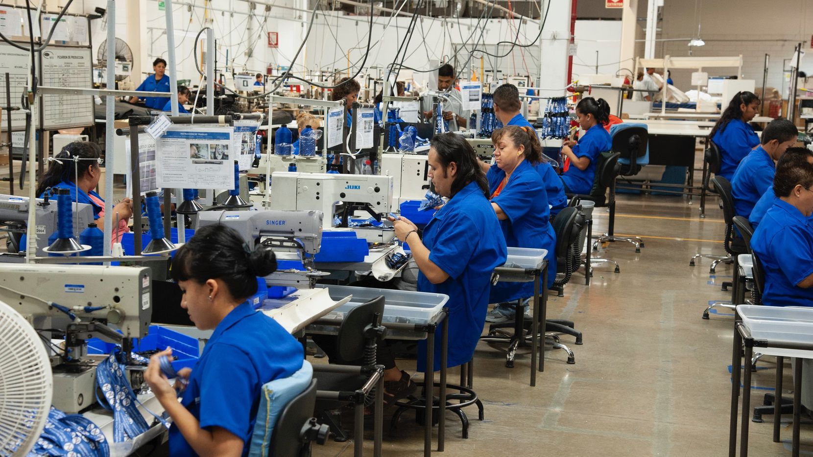 Workers inside an MFI International plant in Ciudad Juarez, Mexico, make fabrics in February 2020. MFI is one of the factories along the border switching to manufacturing medical supplies for the fight against coronavirus.
