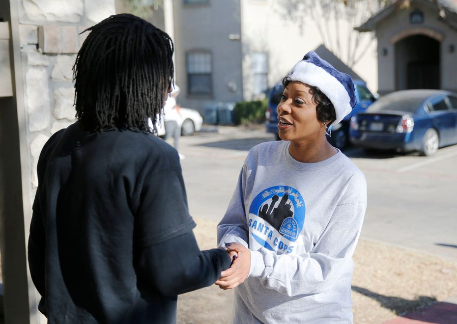 Aris Joseph greets the Dallas police chief during a Santa Cops toy giveaway at his home. (Vernon Bryant/Staff Photographer)