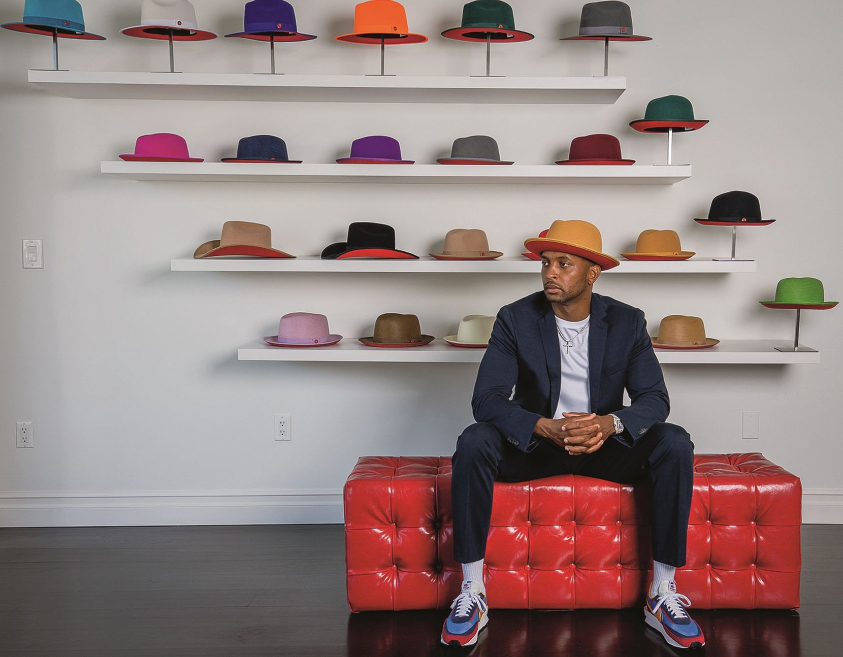 The red under its brim is a signature feature of Keith & James hats. James Keith, milliner from North Carolina, is photographed with his creations. Six custom hats with display-quality clear hatboxes are $95,000 in this year's book.