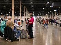 People wait to receive the COVID-19 vaccine at Fair Park in Dallas on Thursday, Jan. 14, 2021. (Juan Figueroa/ The Dallas Morning News)