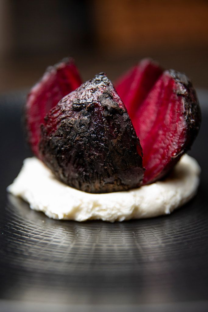 Beets, roasted in the wood-burning stove, are served atop goat cheese at Tulum.
