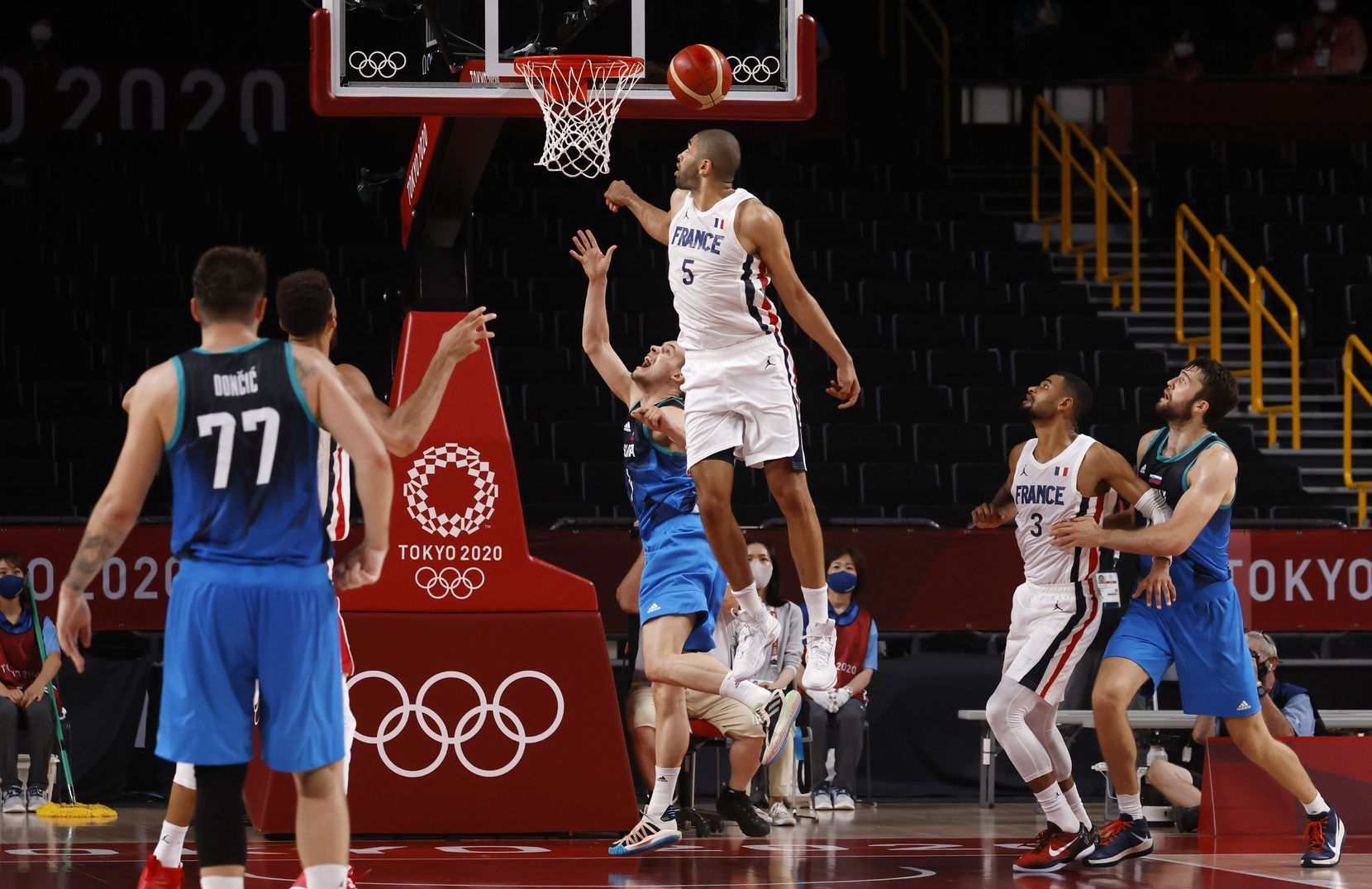 Slovenia's Klemenn Prepelic (7) last second shot is blocked by France's Nicolas Batum (5) at the end of the fourth quarter of play of a men's basketball semifinal at the postponed 2020 Tokyo Olympics at Saitama Super Arena, on Thursday, August 5, 2021, in Saitama, Japan. France defeated Slovenia 90-89. Slovenia will play in the bronze medal game. (Vernon Bryant/The Dallas Morning News)