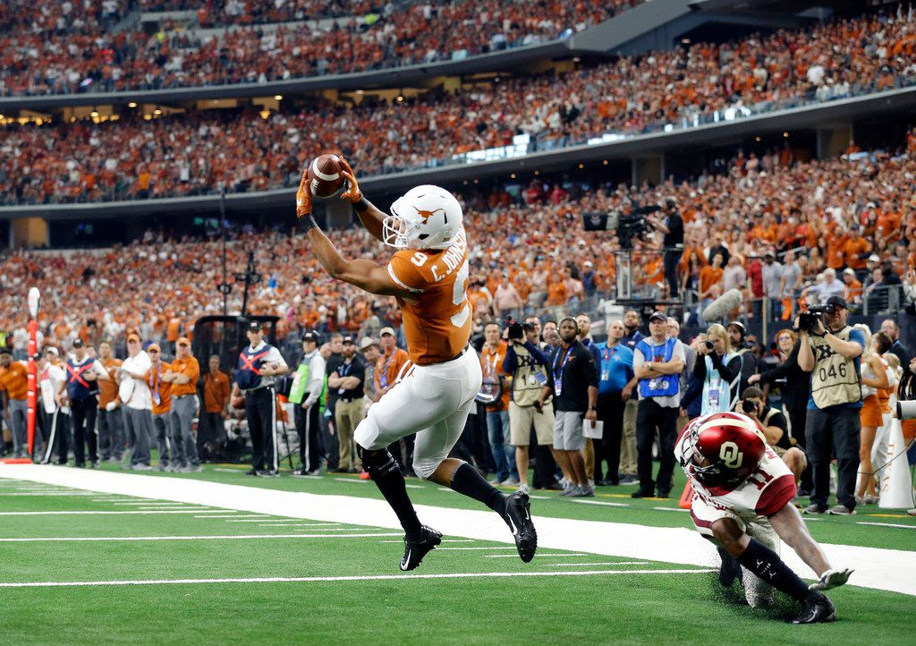Texas Longhorns wide receiver Collin Johnson (9) is wide open in the end zone but drops the pass and is flagged for interference on Oklahoma Sooners cornerback Parnell Motley (11) during the second quarter of the Big XII Championship at AT&T Stadium in Arlington, Texas, Saturday, December 1, 2018. (Tom Fox/The Dallas Morning News)