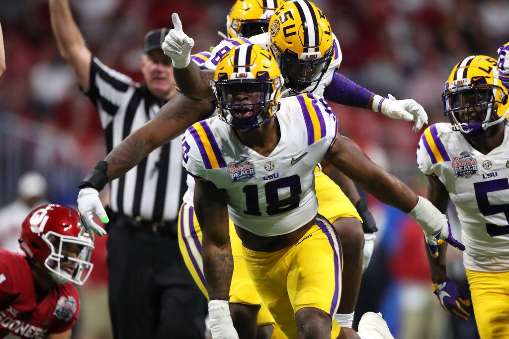 ATLANTA, GEORGIA - DECEMBER 28: Linebacker K'Lavon Chaisson #18 of the LSU Tigers and teammates celebrate a defensive stop against the Oklahoma Sooners during the Chick-fil-A Peach Bowl at Mercedes-Benz Stadium on December 28, 2019 in Atlanta, Georgia. (Photo by Gregory Shamus/Getty Images)