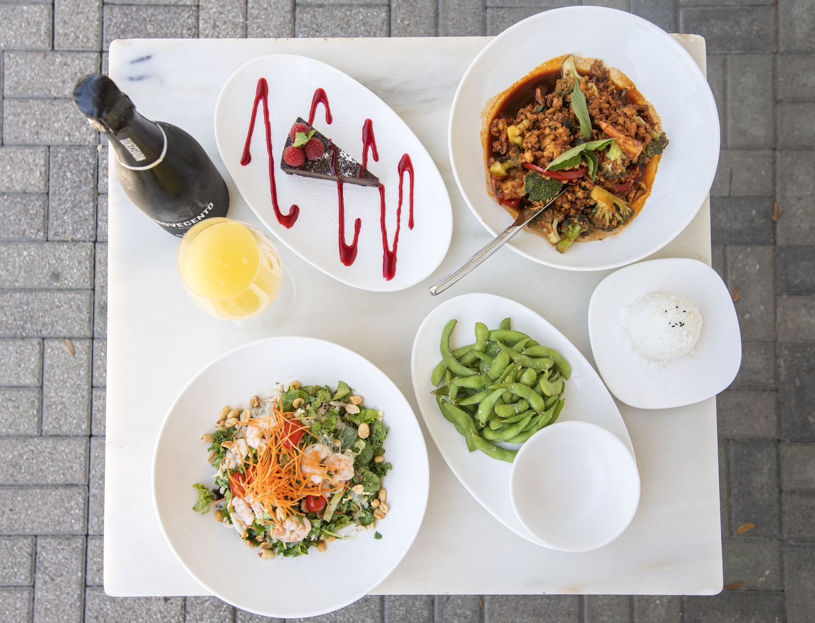 Asian Mint offers various Mother's Day dishes. Asian noodle salad, bottom right; shrimp and chicken basil, top right; edamame, bottom right; and chocolate flourless cake, top right; are photographed, April 23, 2020, at the Dallas location.