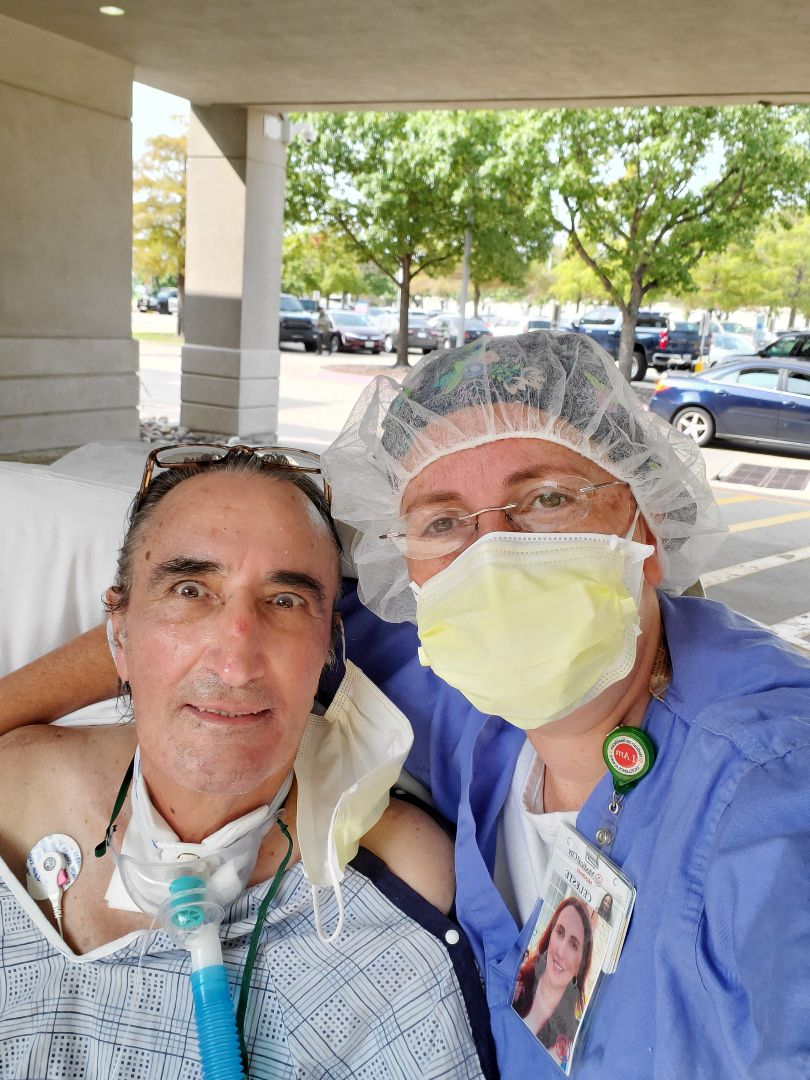 Ceasar Ronavez and his ICU nurse Celeste Giannelli pose for a photo. Ronavez spent more than 100 days in the hospital because of COVID-19. At one point, Giannelli decided to wheel him outside to feel the sun and breeze, a moment he credits with reminding him of life's beauty.