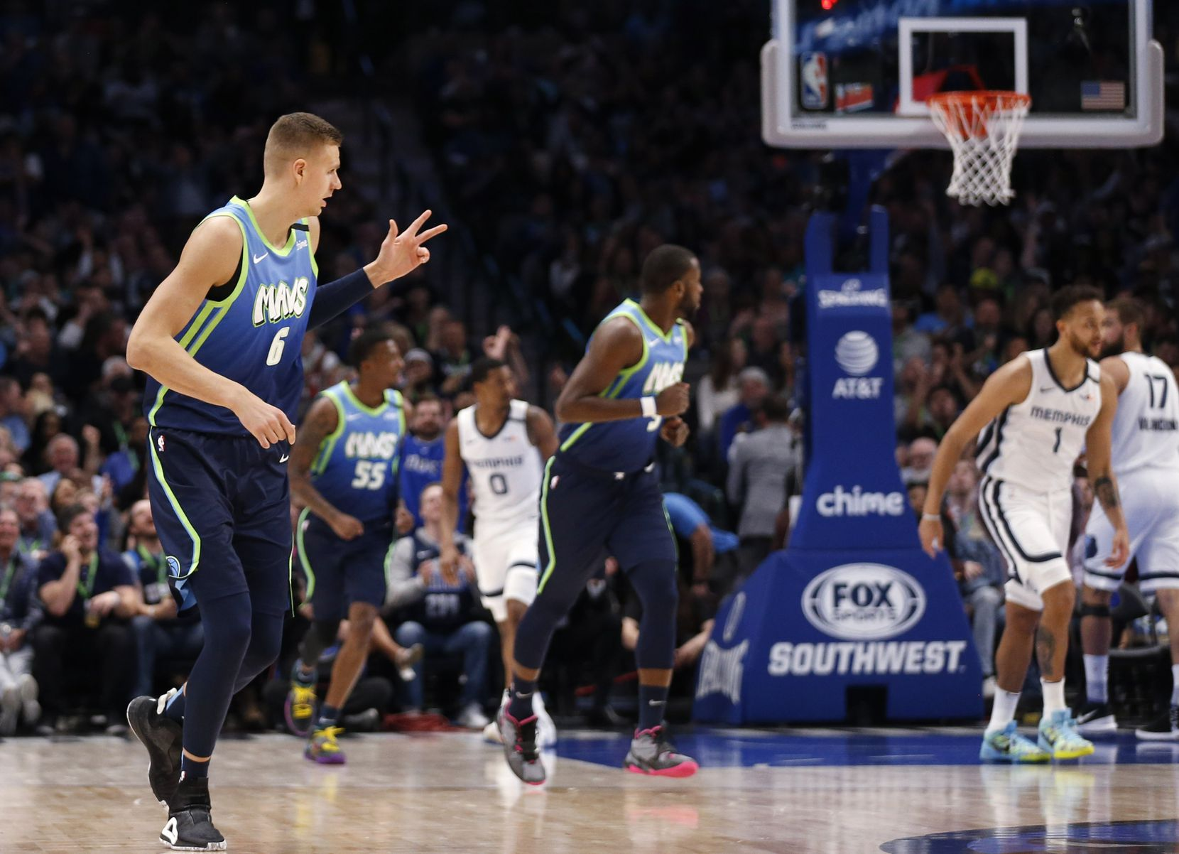 Dallas Mavericks forward Kristaps Porzingis (6) celebrates after a made three pointer in a game against the Memphis Grizzlies during the first half of play at American Airlines Center in Dallas on Friday, March 6, 2020.