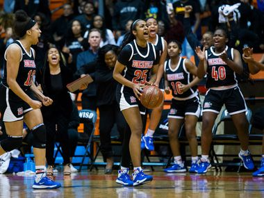 Duncanville's Deja Kelly (25) and her teammates celebrate a foul call during the fourth quarter of a Class 6A Region I quarterfinal girls basketball game between Duncanville and DeSoto on Tuesday, February 25, 2020 at Wilkerson-Greines Activity Center in Fort Worth. (Ashley Landis/The Dallas Morning News)