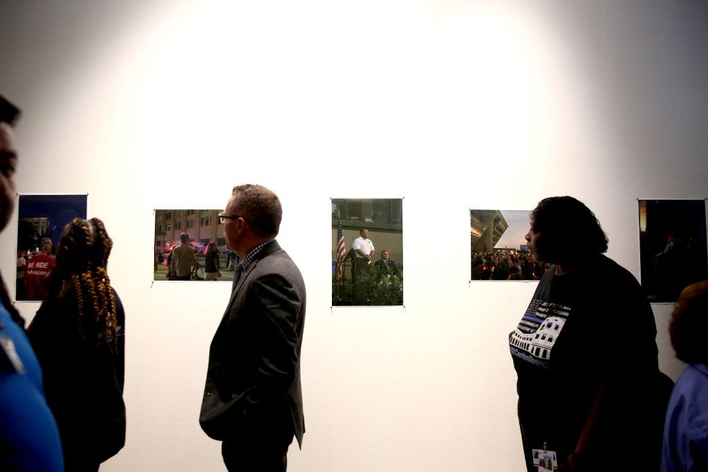 People view a gallery of images submitted by El Centro students during the Renewal and Resilience Commemorative Ceremony to honor the fallen officers.