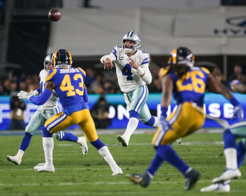 Dallas Cowboys quarterback Dak Prescott (4) fires off a pass during the first half of a NFC divisional playoff game between the Dallas Cowboys and the Los Angeles Rams on Saturday, Jan. 12, 2019 at Los Angeles Memorial Coliseum in Los Angeles. (Ryan Michalesko/The Dallas Morning News)