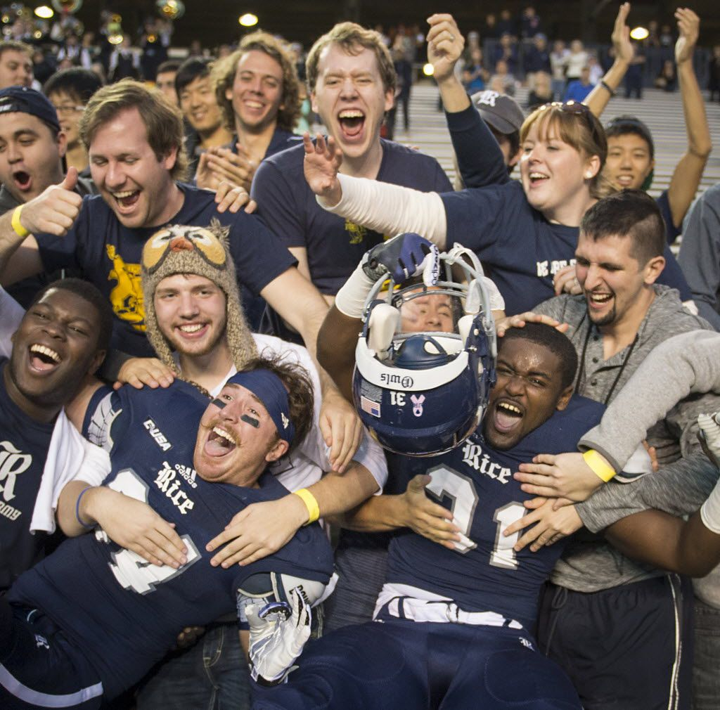 Rice safety Paul Porras (24) and linebacker Broderick Jackson (31) celebrate with fans after 17-14 victory over Tulane in an NCAA college football game against Rice at Rice Stadium, Saturday, Nov. 30, 2013, in Houston. (AP Photo/Houston Chronicle, Smiley N. Pool) MANDATORY CREDIT 12012013xSPORTS2Opp