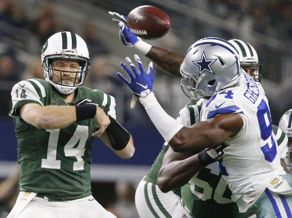 New York Jets quarterback Ryan Fitzpatrick (14) throws a pass under pressure from Dallas Cowboys defensive end Randy Gregory (94) in the second quarter during the New York Jets vs. Dallas Cowboys NFL football game at AT&T Stadium in Arlington on Saturday, December 19, 2015. (Louis DeLuca/The Dallas Morning News)