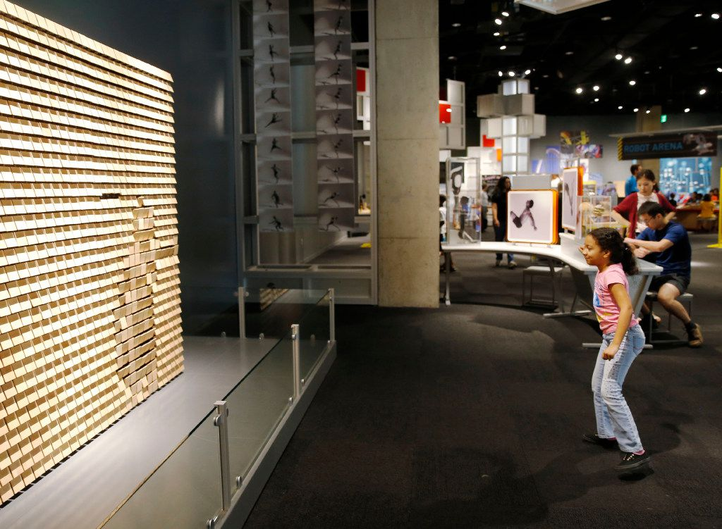Sylvia Rodriguez, 9, of Spring plays with an interactive exhibit at the Perot Museum of Nature and Science in Dallas.