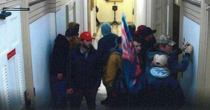 Kerry Wayne Persick, in red cap, inside the U.S. Capitol building on Jan. 6, 2021.