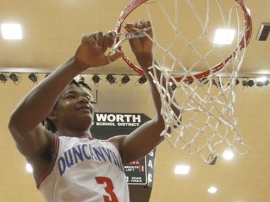Duncanville guard C.J. Ford (3) was all smiles as he cuts a portion of the net from the rim following the Panthers' 59-43 victory over Odessa Permian to advance to the UIL state tournament. The two teams played in the Class 6A Region 1 championship boys basketball playoff game at Wilkerson-Greines Activity Center in Fort Worth on March 7, 2020.