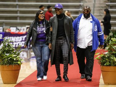 Skyline's Arabia Bradford, who signed to play football with Tarleton State, walks with his family during a Dallas ISD signing day event at Ellis Davis Field House on Wednesday, Feb. 5, 2020 in Dallas.
