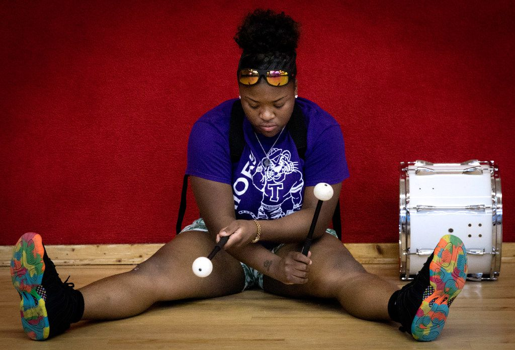 Todja Washington, 18, waits for the Dallas Mass Band practice to begin at the Braswell Child Development Center in Dallas on June 21.