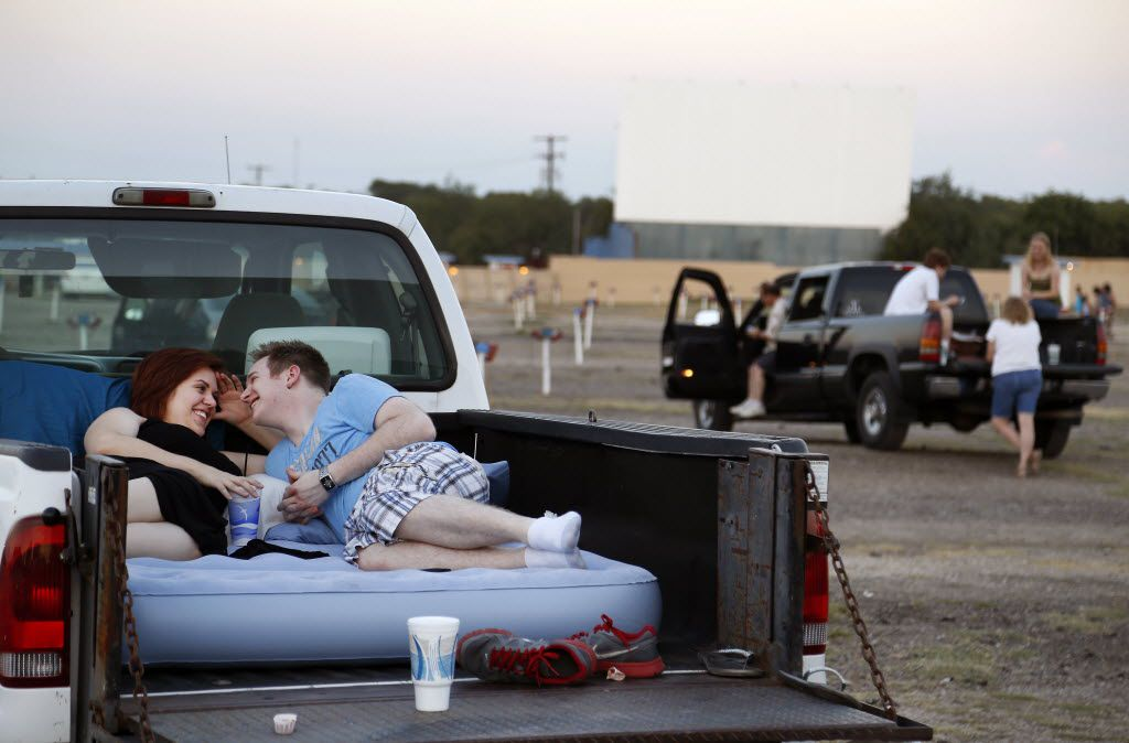 Rachel Leigh Marek and Andrew Shepherd  wait for their movie to start at the Galaxy Drive-In in Ennis on Aug. 6, 2014.