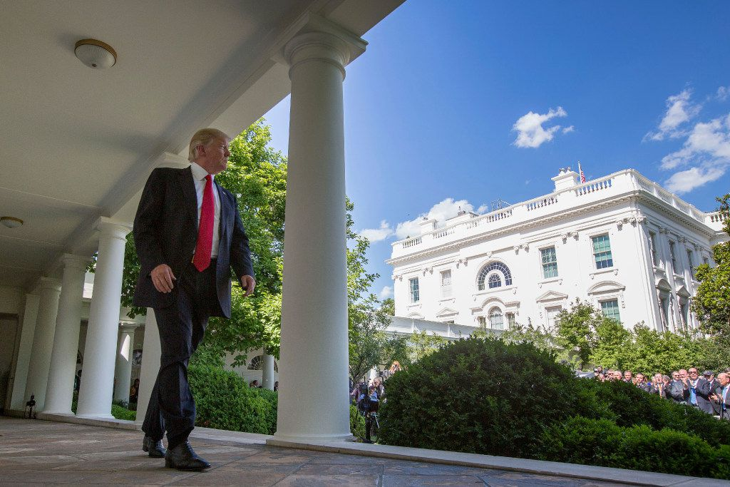 President Donald Trump walks to the Oval Office of the White House in Washington, Thursday, June 1, 2017, after speaking in the  Rose Garden about the US role in the Paris climate change accord. (AP Photo/Andrew Harnik)