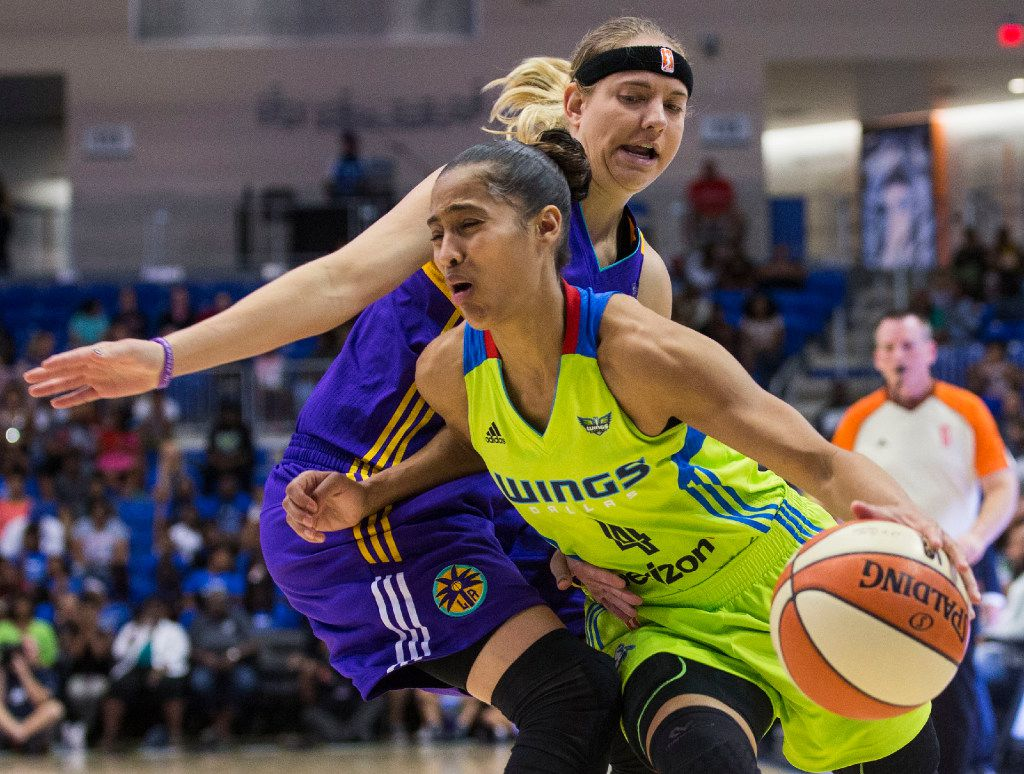 Dallas Wings guard Skylar Diggins-Smith (4) drives past Los Angeles Sparks guard Sydney Wiese (24) during a WNBA match-up between the Dallas Wings and the Los Angeles Sparks on Sunday, August 6, 2017, at College Park Center, in Arlington, Texas. (Ryan Michalesko/The Dallas Morning News)