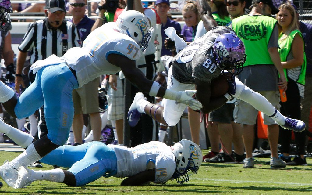 TCU receiver Al'Dontre Davis (80) splits the defense of Southern defensive back Demerio Houston (14) and linebacker Caleb Carter (47) following a first half reception.The two teams played their season opening football game at Amon G. Carter Stadium in Fort Worth on September 1, 2018. (Steve Hamm/ Special Contributor)