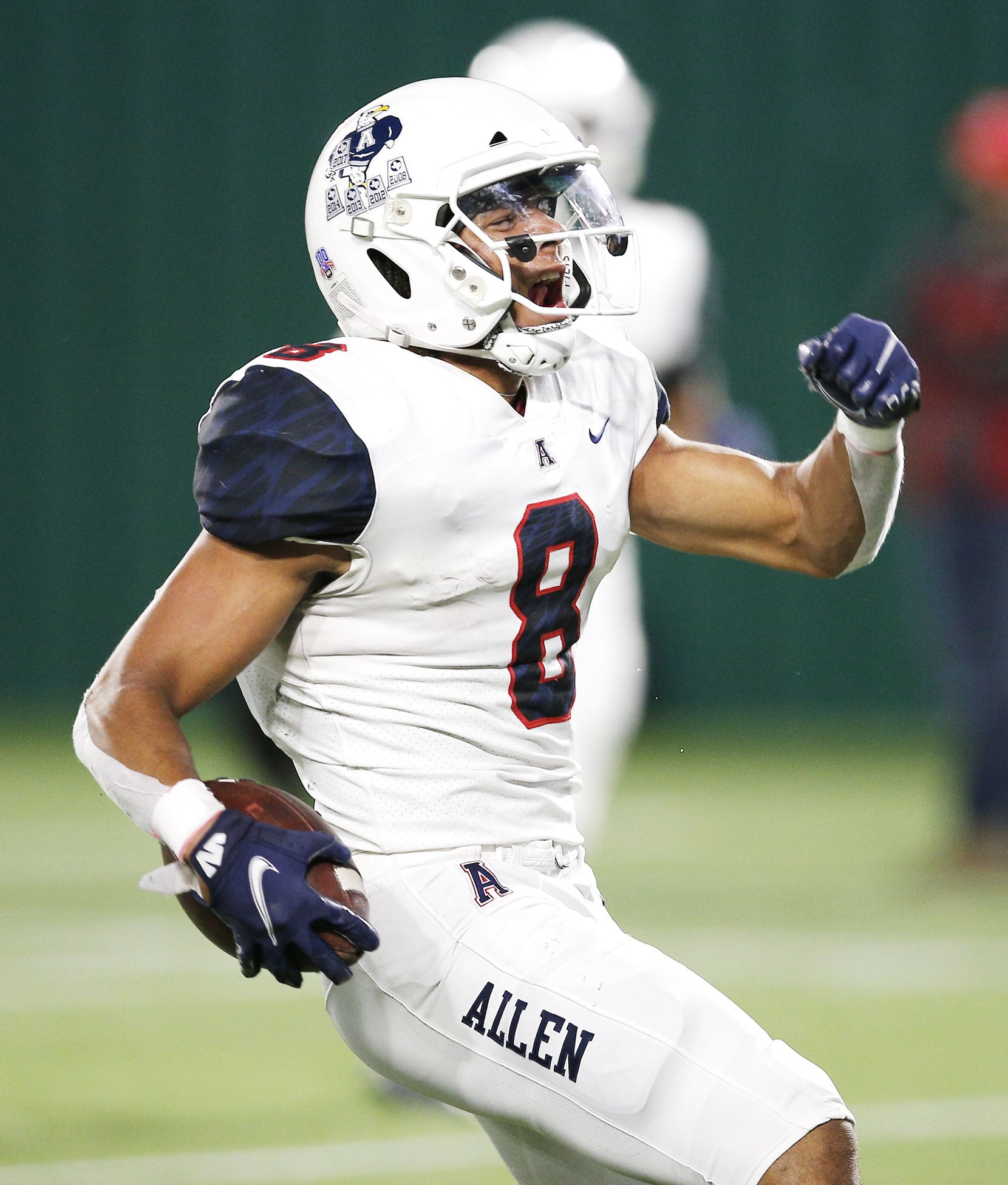 Allen senior wide receiver Blaine Green (8) celebrates scoring a touchdown during the first half of a high school Class 6A Division I Region I semifinal football game against Euless Trinity at Globe Life Park in Arlington, Saturday, December 26, 2020. (Brandon Wade/Special Contributor)