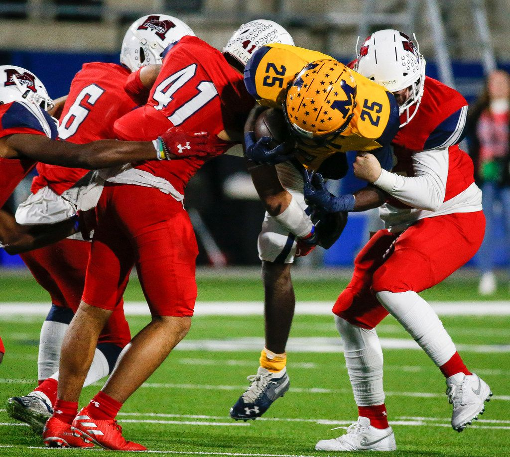 McKinney's Lamarrya Ransem (25) is brought down by a swarm of McKinney Boyd defense during the first quarter of a high school football matchup between McKinney and McKinney Boyd at McKinney ISD Stadium on Friday, Nov. 8, 2019 in McKinney, Texas. (Ryan Michalesko/The Dallas Morning News)