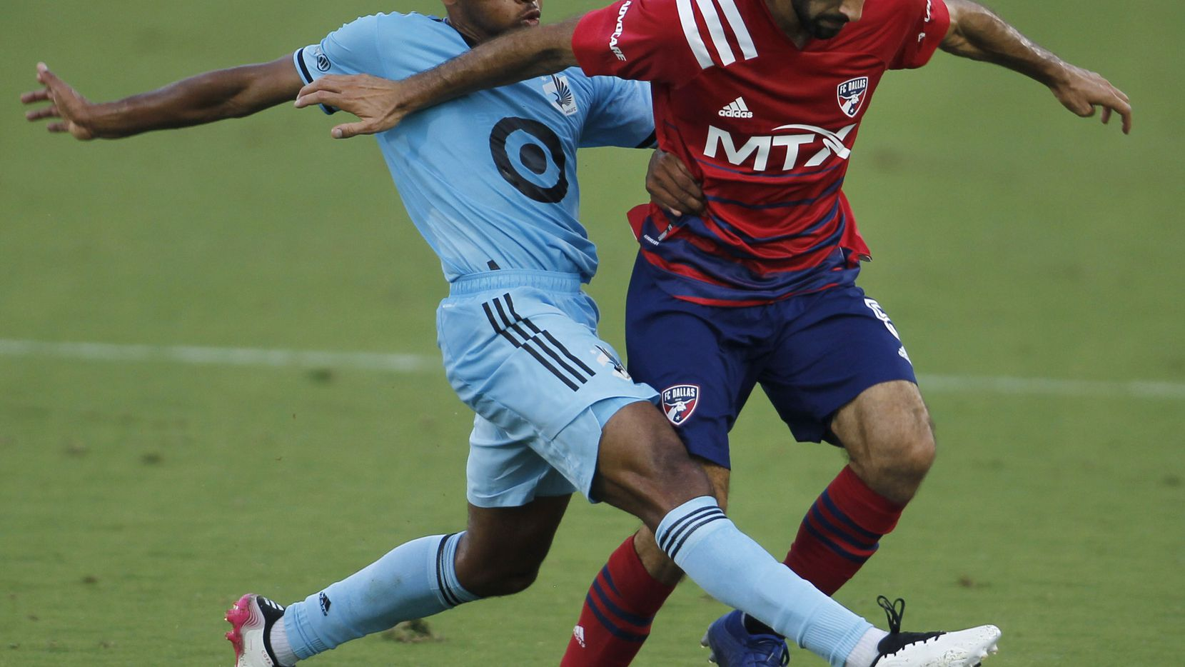FC Dallas midfielder Facundo Quignon (5), right, tries to maintain ball control as Minnesota United midfielder Jacon Hayes (5), challenges defensively during first half play. The two teams played their MLS match at Toyota Stadium in Frisco on June 19, 2021. (Steve Hamm/ Special Contributor)