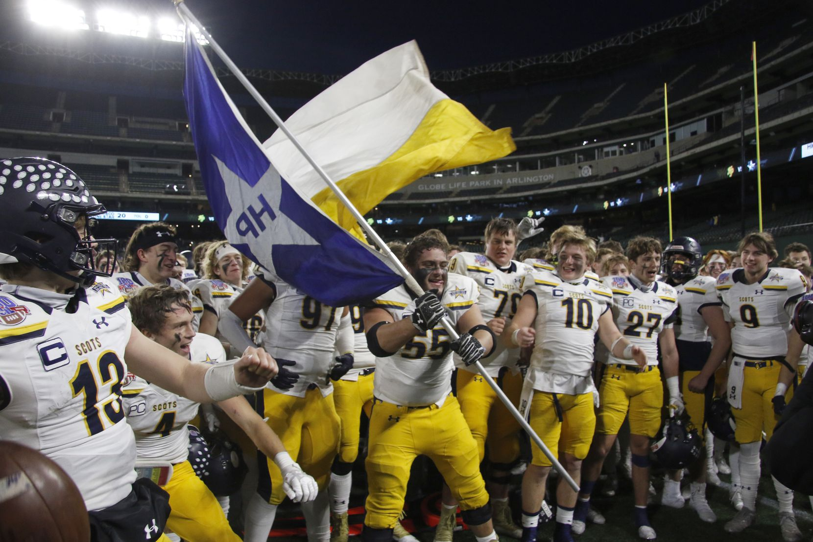 Highland Park offensive lineman Sam Morse (55) handles the flag waving duty as the Scots celebrate following their 30-20 victory over Frisco Lone Star. The two teams played their Class 5A Division l Region ll semifinal football playoff game held at Globe Life Park in Arlington on December 24, 2020. (Steve Hamm/ Special Contributor)