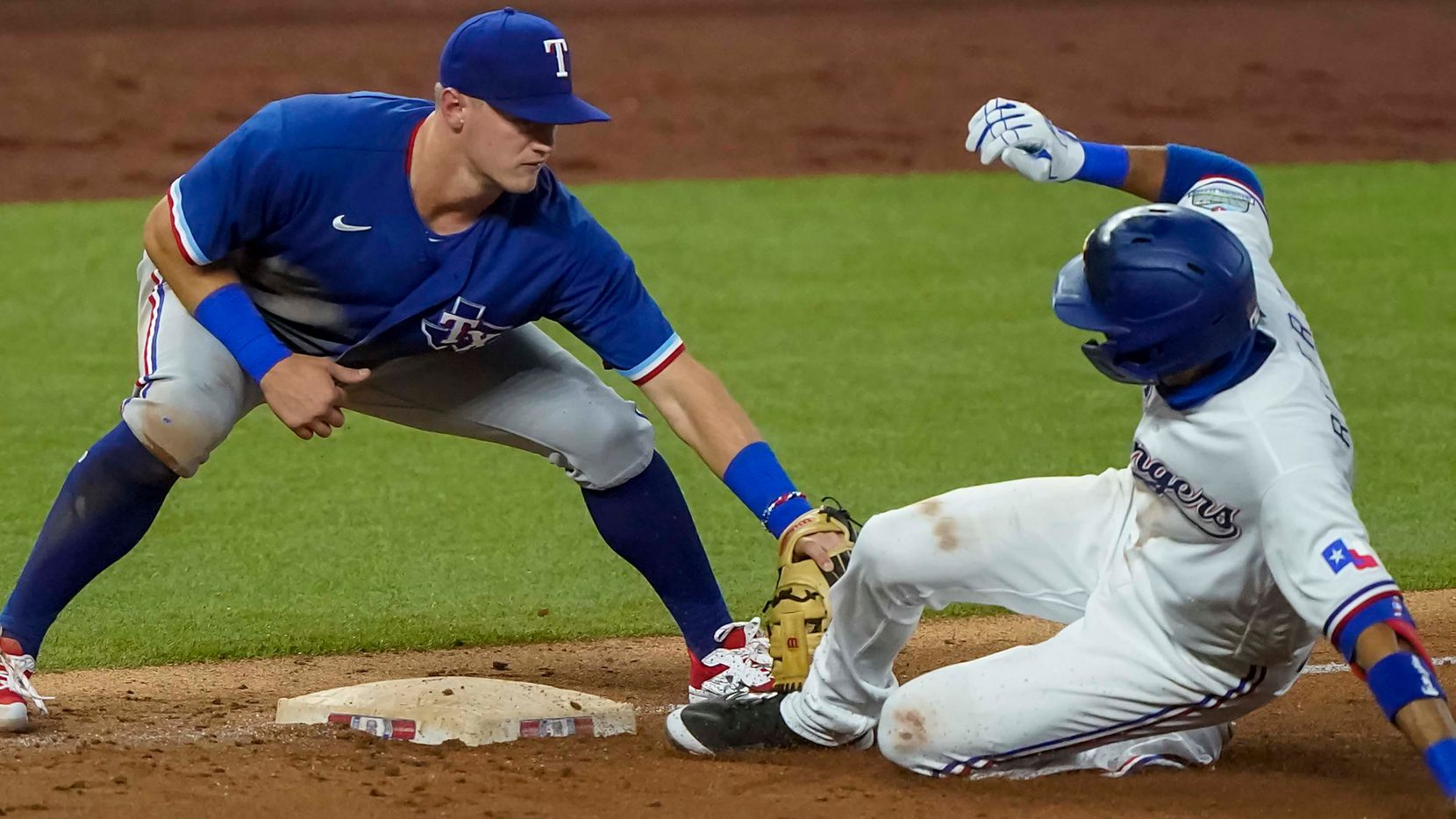 Infielder Yadiel Rivera is out at third base as Josh Jung applies the tag in an intrasquad game during Texas Rangers Summer Camp at Globe Life Field on Saturday, July 18, 2020.
