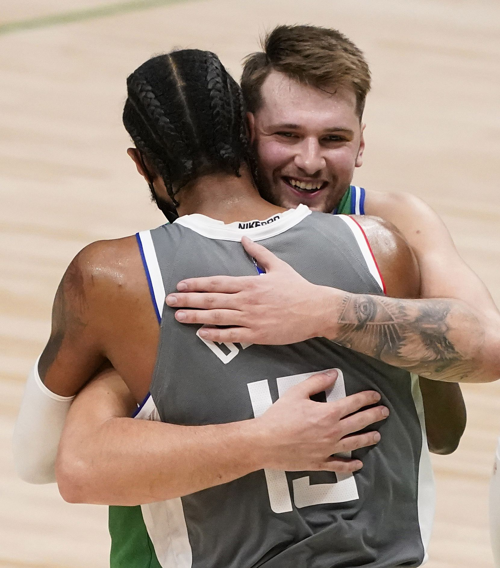 Dallas Mavericks guard Luka Doncic hugs LA Clippers guard Paul George after the Mavericks 105-89 victory in an NBA basketball game at American Airlines Center on Wednesday, March 17, 2021, in Dallas.
