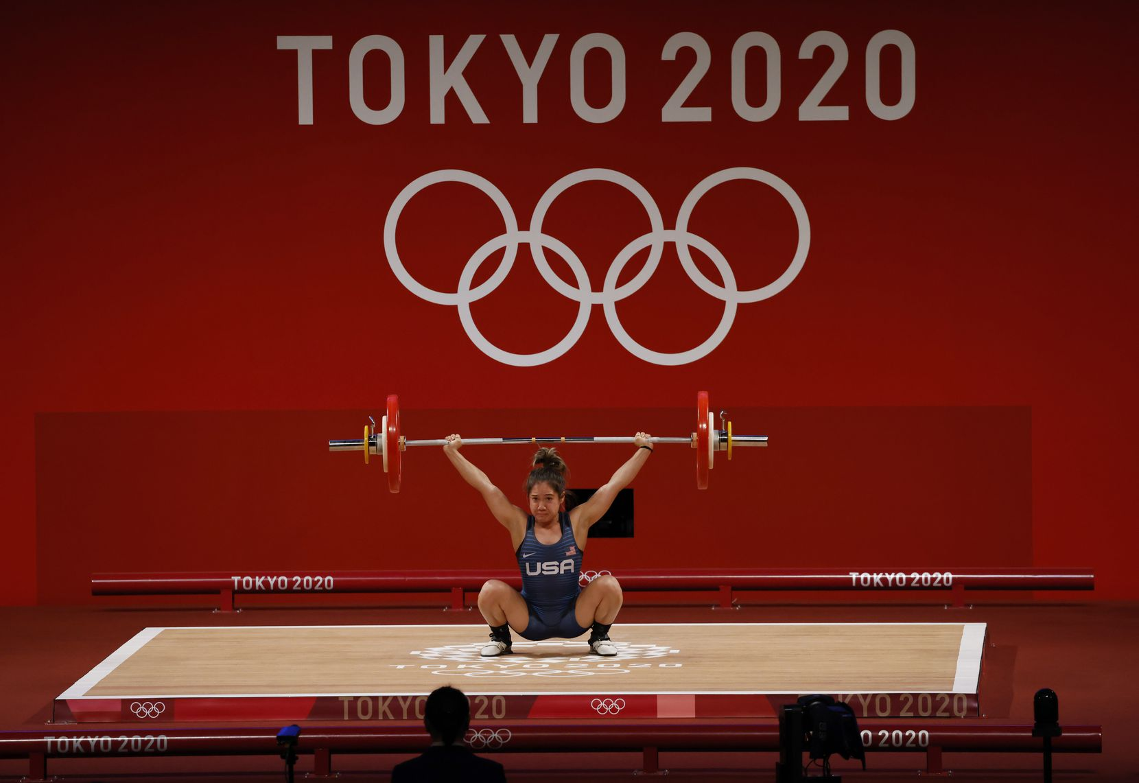 USA's Jourdan Delacruz competes in the second attempt of the snatch round lifting 86 kg during the women's 49 kg weightlifting final  during the postponed 2020 Tokyo Olympics at Tokyo International Forum on Saturday, July 24, 2021, in Tokyo, Japan. (Vernon Bryant/The Dallas Morning News)